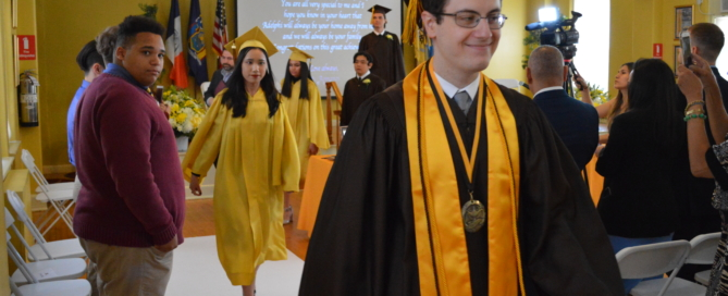 Valedictorian Arber Kadiu leads his fellow graduates out of the John Lockwood Auditorium Theatre!
