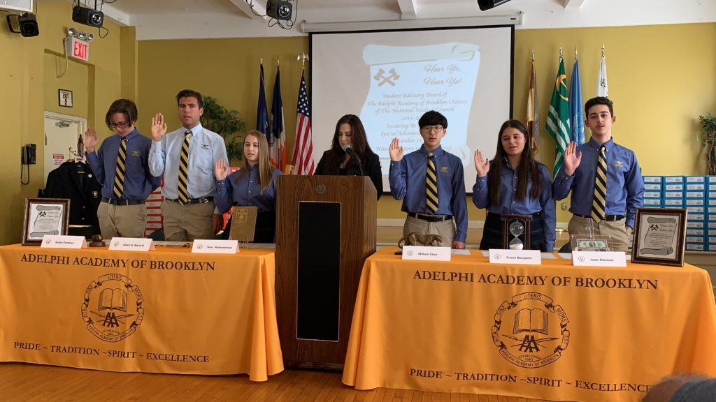 Head of School Ms. Iphigenia Romanos administers the oath of office to incoming Student Advisory Board members.