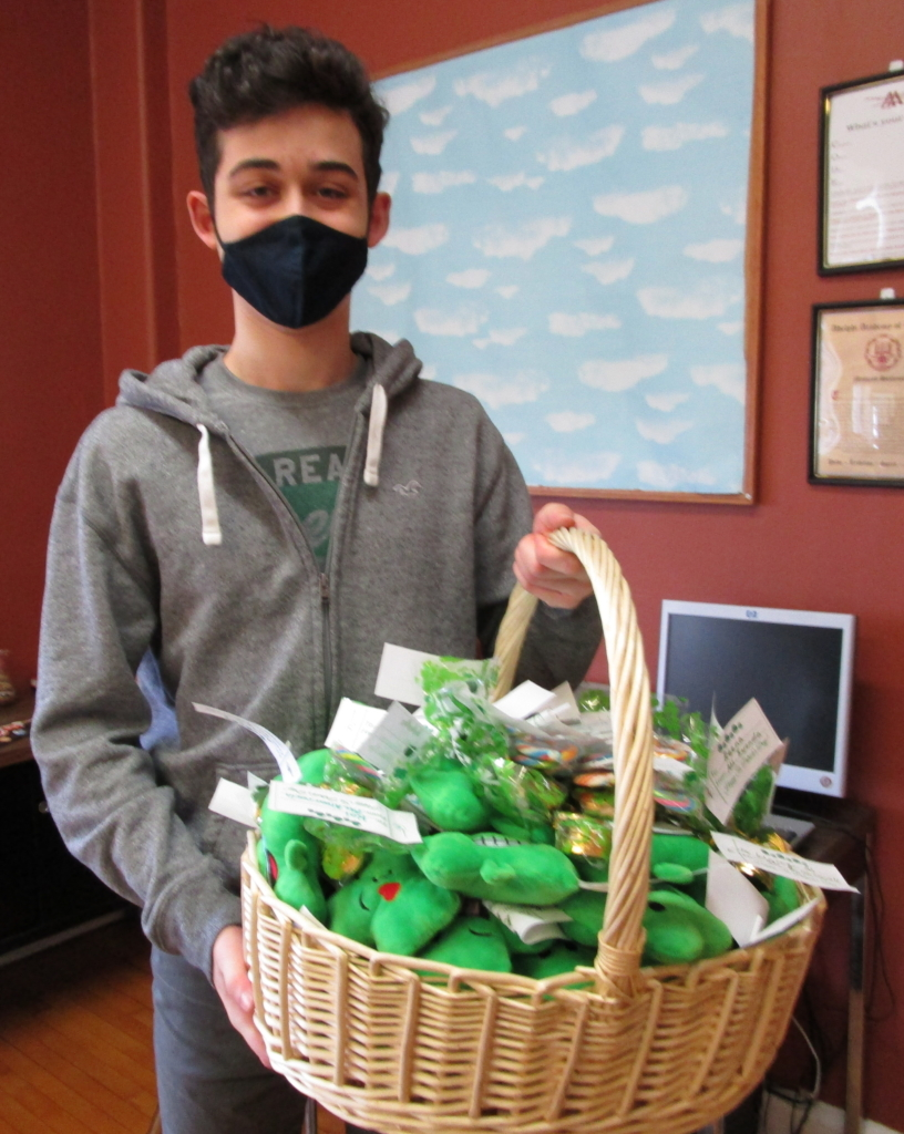 Student Advisory Board member Isaac gets ready to deliver hundreds of St. Patrick's Day Grams!
